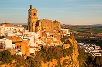 The historic district of the White Town of Arcos de la Frontera dramatically perches on a limestone crack high above the Guadalete river. Prominent th...