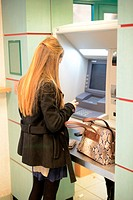 Young Woman or Student Withdrawing Money from Cash Machine in Bank Aix-en-Provence France.