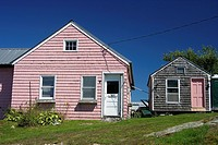 Pink shingled cottage in the fishing village of Gouldsboro, Maine.