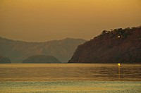Lonely light. Papagayo Bay at sunset.