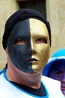 A masked Mardi Gras reveler Pezenas, France