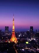 Tokyo tower at night over purple twilight sky. Minato, Tokyo, Japan.