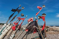 At the mole in the harbour of Vitt are buoys with red and black flags, fishing village of Vitt, municipality of Putgarten, Wittow peninsula, Ruegen Is...