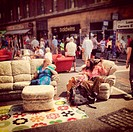 PEOPLE SITTING ON SOFAS AT THE STREETS OF BRISTOL DURING A SUMMER EVENT.BRISTOL.UK.2013.
