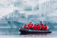 Lindblad Expeditions guests in a Zodiac approach a glacial face at Brown Bluff, Weddell Sea, Antarctica.