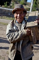 Peru, Quispillacts, Old man carrying wooden box