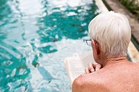 Senior Caucasian man examining swimming pool