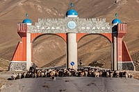 flock of sheeps on road with monument, Kyrgyzstan, Djalalabad, Taskoemuer