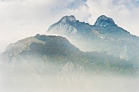 foggy mountains over the fog, piani resinelli, italy