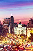 "Metropolis building seen from """"Puerta de Alcala"""" monument by sunset. Madrid, Spain."