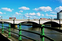Grade II listed Putney Bridge which opened in 1886, with the 21st century glass Putney Wharf Tower on its south side, London, England, Europe.