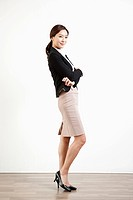 a business woman posing while standing