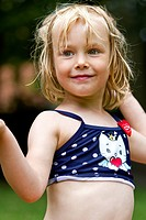 Portrait of smiling little girl wearing bikini top