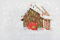 Studio shot of Gingerbread House with snowing effect