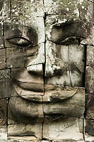 The faces of the Bayon temple. Angkor Thom. Angkor Thom was built as a square, the sides of which run exactly north to south and east to west. Standin...