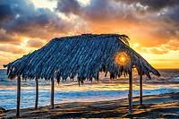 The setting Sun producing a sunstar through the Surf Shack. Windansea Beach La Jolla, California, United States.