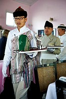 Waiters serving tea in the dining room of the Windamere Hotel in Darjeeling.