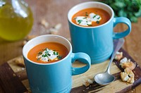Cream of tomato soup topped with cream and chives.