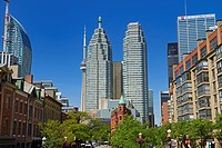 Gooderham Flatiron building with financial district bank towers L tower and CN tower Toronto.