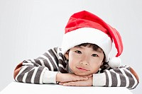 close up shot of a smiling kid with Santa hat