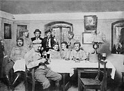 Convalescing German troops enjoy a beer whilst playing cards. 1915