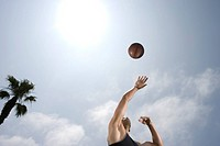 Man Tossing Basketball