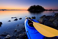 Sea kayak scene at sunrise, Pipers Lagoon Park, Nanaimo, Vancouver Island, British Columbia.