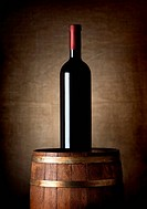 Bottle of wine on a barrel