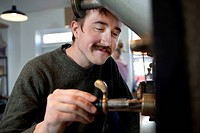 Man repairing coffee grinder