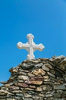orthodox cross at an ancient wall