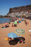 Colorful sunbeds and parasols on the beach of Puerto de Mogan, Gran Canaria, Canary Islands, Spain, Europe.