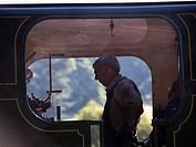 driver and fireman prepare a locomotive at Peak Rail Steam Railway at Matlock, Derbyshire, UK.