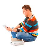 Man college student sitting and reading book studying for exam