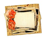 Pile of old photos and letters with bouquet of dried roses on white background isolated