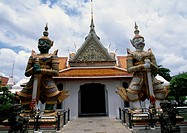 Demon guardians, statues in front of the Wat Arun (Temple of Dawn), Bangkok, Thailand, 17th century.
