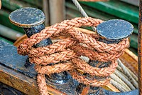Rope with anchored ship.