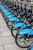 Row of parked Transport for London Barclays bicycles for hire, London. The hire scheme was introduced in 2010 by London mayor Boris Johnson.