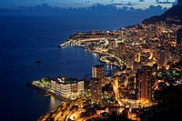 Aerial view over the city and port of Monte Carlo, Monaco along the French Riviera at night
