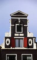 Pediment of a building on the Herengracht canal (Patricians' Canal), Jordaan, Amsterdam, The Netherlands.