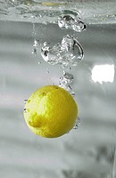 lemon submerging in water