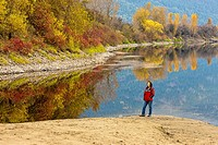 A woman takes in the beauty of the Kootenai River in autumn.