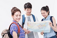 Two women and a man looking at a map