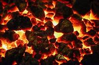 glowing coal in a fire bowl.