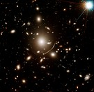 Young galaxy lensed by cluster Abell 383. The central bright object is a young galaxy that formed 13.5 billion years ago, 200 million years after the ...