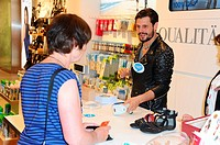 Manuel Cortez helping out at Reno's shoe store cash register at Forum Steglitz in aid of Deutschland rundet auf charity campaign. Featuring: Manuel Co...
