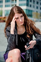 Problems - business woman reading message on phone