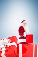 Santa standing in large gift
