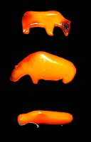 Amber amulet figures sculpted to represent animals hunted in the Danish Stone age 8000 BC