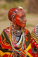 Portrait of a Masai woman, Kenya. Kenya's Masai Mara National Reserve is an area of gentle rolling hills, woodland, and acacia trees which is watered ...