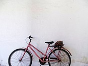 Bicycle parked in front of a wall, Vitoria, Espirito Santo, Brazil.